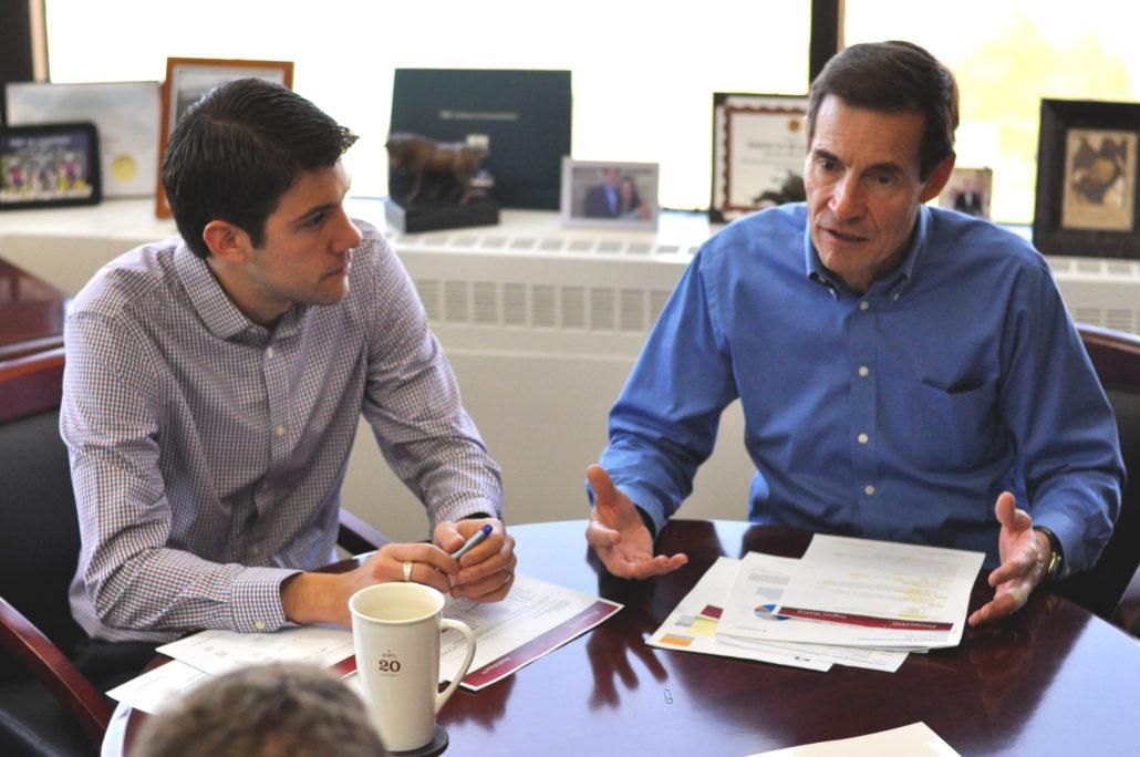 Steve Booren and John Booren meeting with a client