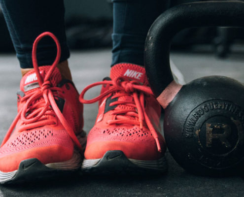 Tennis shoes and a kettle bell