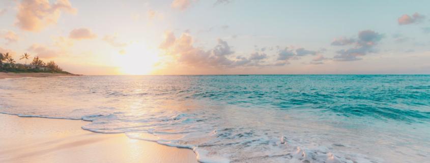 Sun setting over a tropical beach