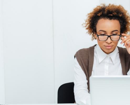 Woman viewing a laptop