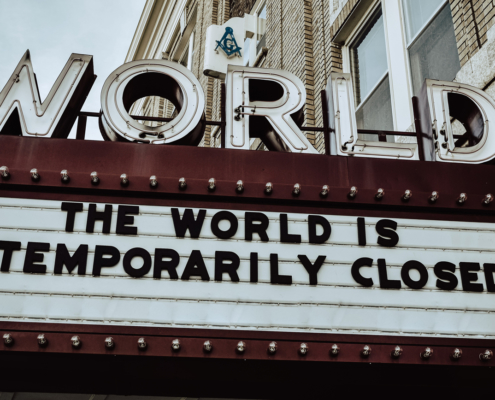"Marquis displaying ""The World is Temporarily Closed"""