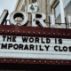 """Marquis displaying """"The World is Temporarily Closed"""""""