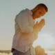 man praying on top of mountain